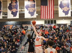 Connor McCance winning the opening tip-off for Oswego.