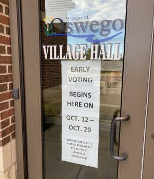 Oswego Village Hall door showing sign that reads