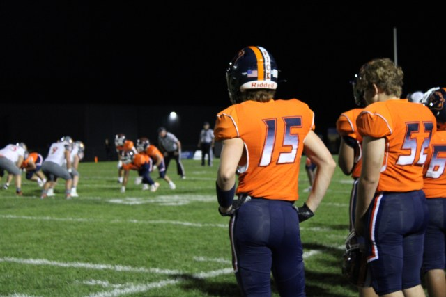 Logan Blair watches the game closely on the sidelines