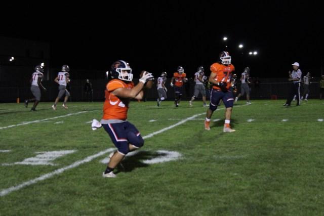 Nick Scott holds on tightly to the ball after a catch