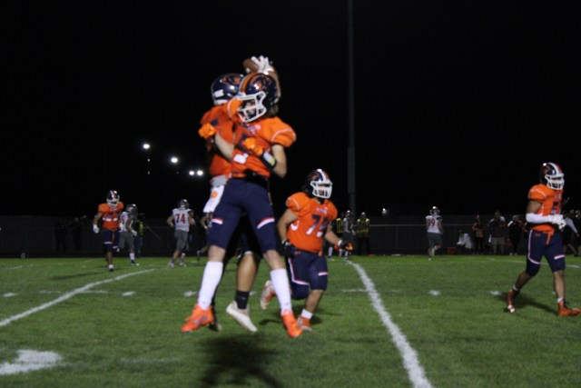 Emery Veya and RJ Cook jump against each other in celebration after a play
