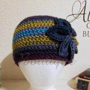 Crochet flower beanie made with lion brand landscapes yarn.  Purchase the pattern here