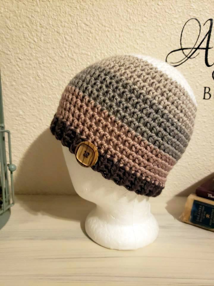 Crochet beanie with button made with Caron x Pantone yarn in River Rock