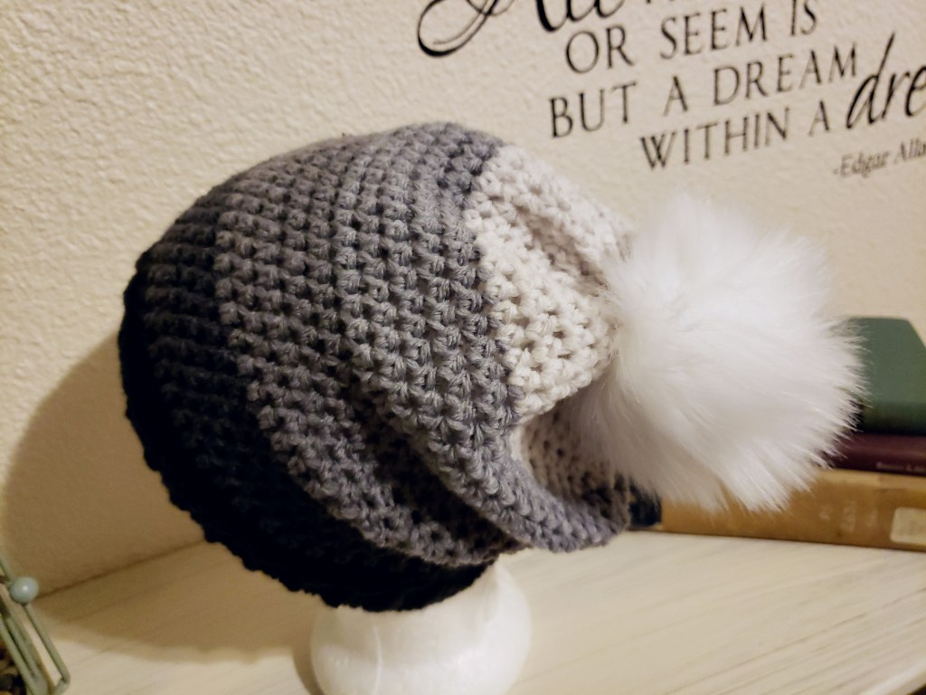 crochet slouch beanie with faux fur pom pom made with Big Twist Gradients yarn in charcoal with a size I hook