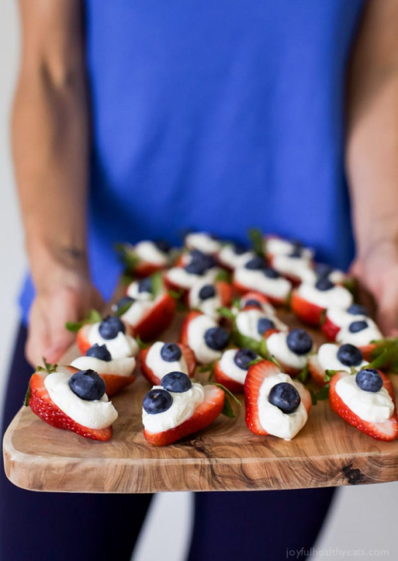 Cheesecake Stuffed Strawberries | Looking for delicious low carb and Keto 4th of July Desserts? I've got the perfect treats for you! These 4th of July Keto desserts recipes are perfect for the celebration and will make sure you stay on track with your ketogenic diet while still enjoying mouthwatering sugar-free and low carb keto desserts. How to have a low carb 4th of July party. #ketodessert #lowcarbdessert #fatbombs #4thofjuly #4thofjulydesserts #4thofjulyrecipes