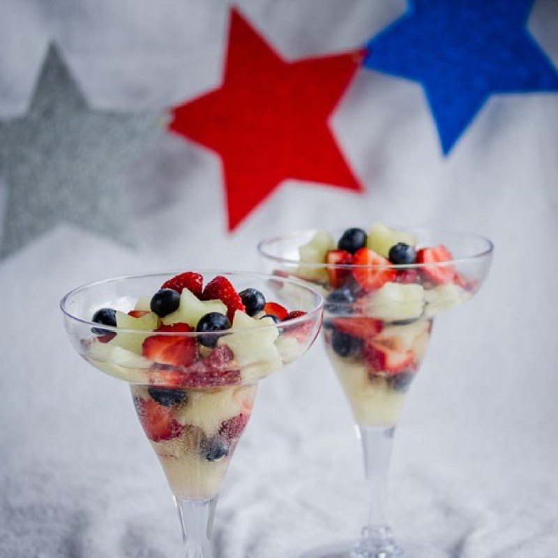 Festive Fruit Salad | Looking for delicious low carb and Keto 4th of July Desserts? I've got the perfect treats for you! These 4th of July Keto desserts recipes are perfect for the celebration and will make sure you stay on track with your ketogenic diet while still enjoying mouthwatering sugar-free and low carb keto desserts. How to have a low carb 4th of July party. #ketodessert #lowcarbdessert #fatbombs #4thofjuly #4thofjulydesserts