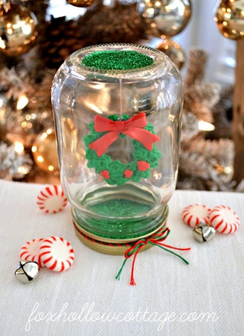Dollar Tree Mason Jar Christmas Snow Globe by Fox Hollow Cottage - 30 Incredible Dollar Store DIY Christmas Decor Ideas. Easy to make decorations that you can do on a small budget. Make beautiful and easy centrepieces, ornaments, candle holders and mason jar crafts. These awesome Dollar Tree DIY Christmas crafts are simple enough to be made with your kids. Just click on this to find out more or pin for later!