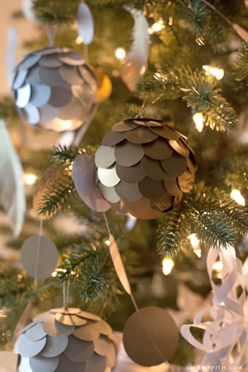 Metallic Paper Ball Christmas Tree Ornaments by Lea Griffith - 30 Incredible Dollar Store DIY Christmas Decor Ideas. Easy to make decorations that you can do on a small budget. Make beautiful and easy centrepieces, ornaments, candle holders and mason jar crafts. These awesome Dollar Tree DIY Christmas crafts are simple enough to be made with your kids. Just click on this to find out more or pin for later!