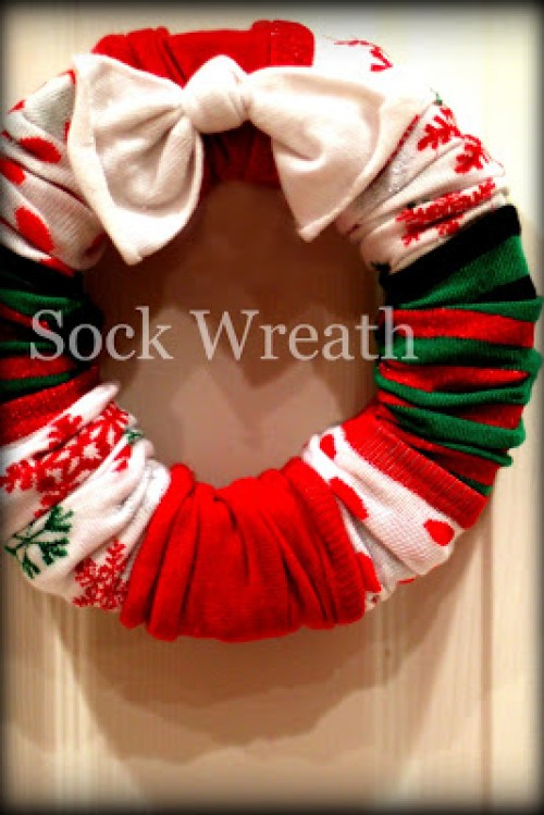 Christmas Sock Wreaths by Work In Progress Kits - 30 Incredible Dollar Store DIY Christmas Decor Ideas. Easy to make decorations that you can do on a small budget. Make beautiful and easy centrepieces, ornaments, candle holders and mason jar crafts. These awesome Dollar Tree DIY Christmas crafts are simple enough to be made with your kids. Just click on this to find out more or pin for later!