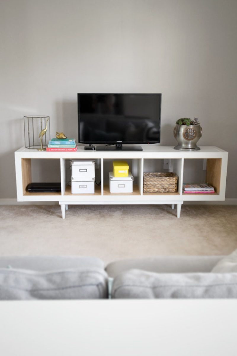 Shelving Unit To TV Stand - 21 genius DIY IKEA Kallax hacks to organize your bedroom, playroom, kitchen, entryway, closet, and office. #ikeahack #ikeakallax #kallax #ikeafarmhouse #ikeaideas #ikea