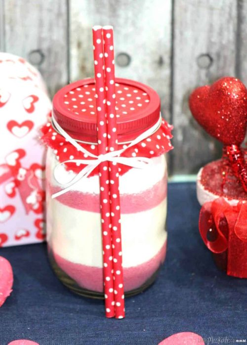 Valentines Gifts In A Jar to Impress Everyone on Your List This Valentine's Day! These fun & easy Valentines gift ideas are perfect for your boyfriend, mom, dad, and friends! Number 4 Is The Perfect Romantic Gift for Men!! From spas in a jar to hot chocolate cookie mixes and sweets, this list of Valentine's Day Mason jar gifts will have you covered!