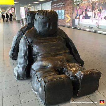"This is a sculpture you can see at the Schiphol airport in Amsterdam. It's called, ""Two incredible sitting black snowmen."""