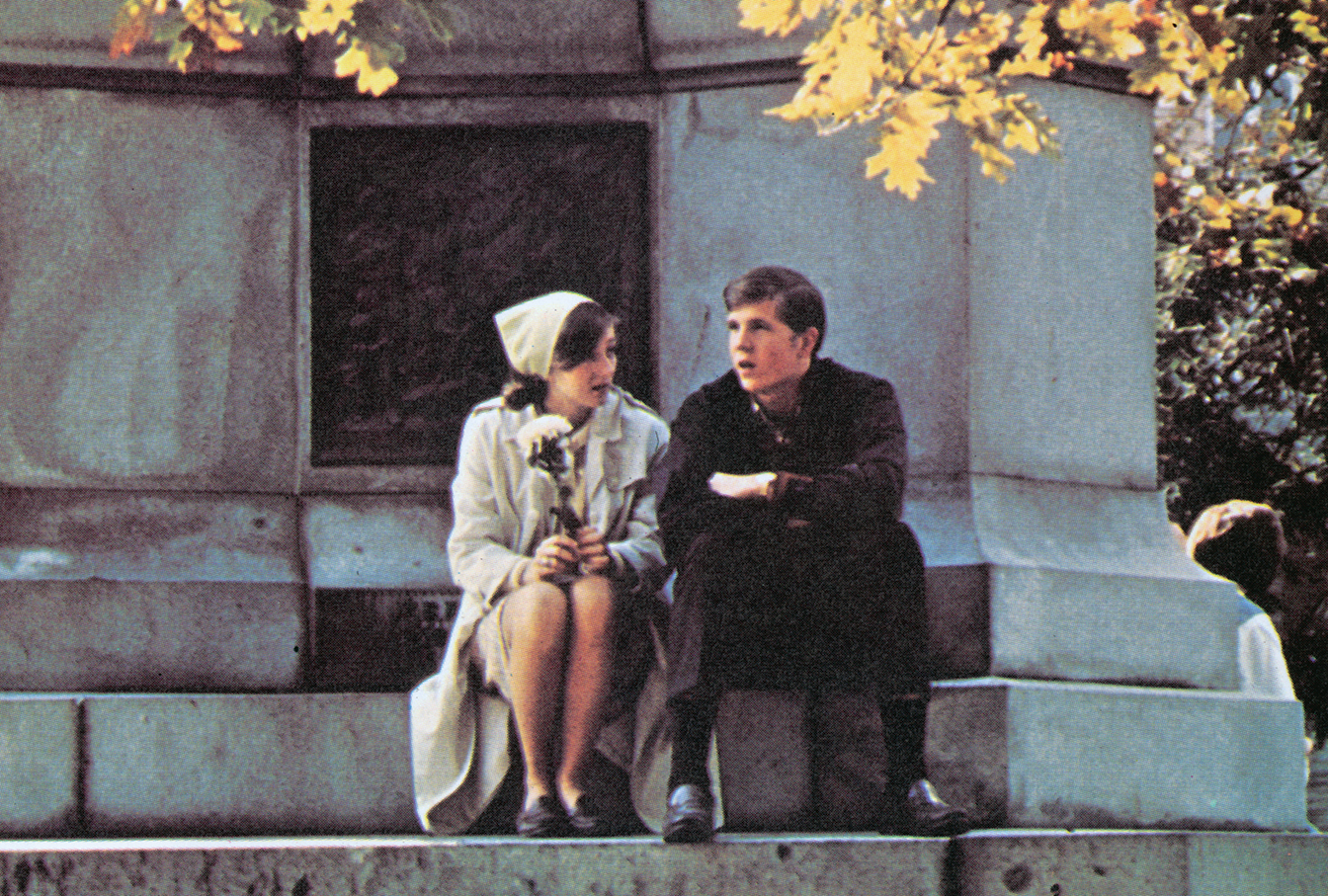 A pair of students connect at the Soldiers and Sailors Civil War Memorial on College Green, 1968 Athena yearbook. Photo courtesy of the Mahn Center for Archives & Special Collections