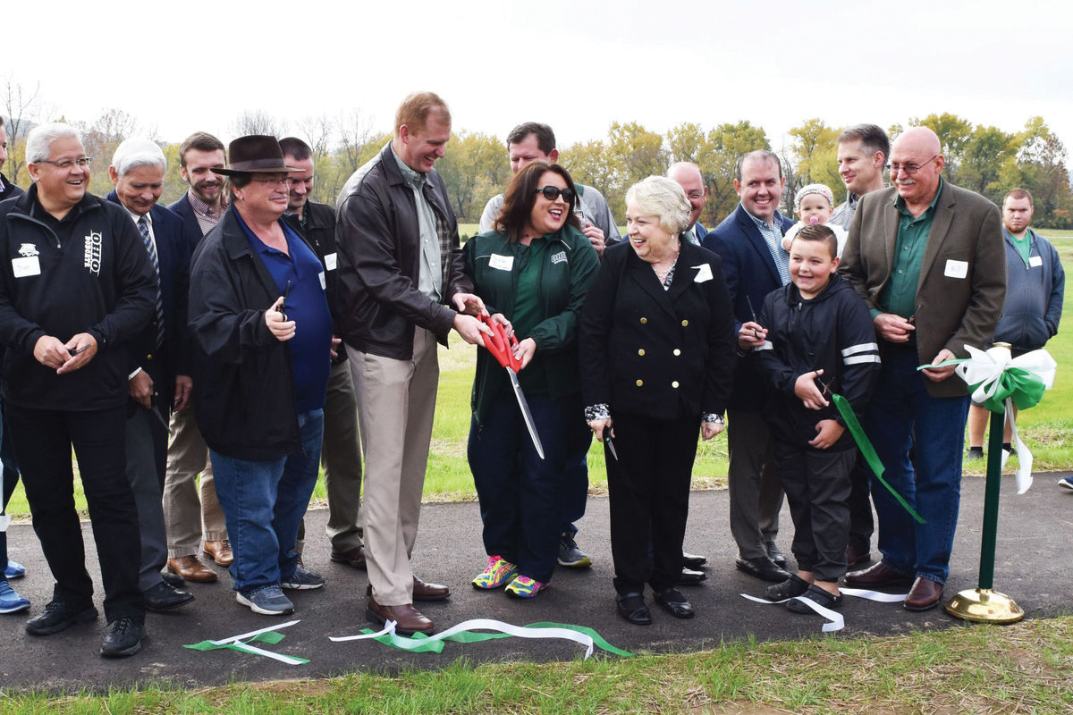 Representative Ryan Smith, Ohio House District 93, and Southern Campus Dean Nicole Pennington ceremonially cut the ribbon on Proctorville Center Park. Photo courtesy of the Southern Campus.