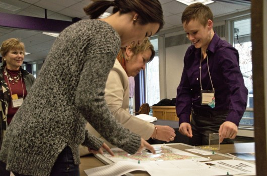 At the 2018 Annual Conference Assembly, Missional Consultant Jessica Schrock-Ringenberg (right) invited participants interested in being part of a missional network to plot their congregations on a map of Ohio.