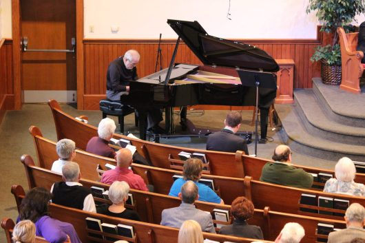 """George Bixler presented a piano arrangement of """"Great is Thy Faithfulness,"""" the theme song selected for the Oak Grove bicentennial."""