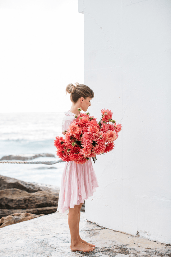 girls holding flowers  Oh Joy