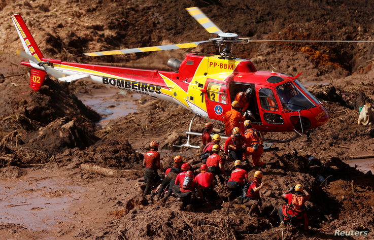 Members of a rescue team search for victims after a tailings dam owned by Brazilian mining company Vale SA collapsed, in Brumadinho, Brazil, Jan. 28, 2019.