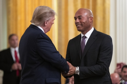 President Donald Trump shakes hands with former New York Yankees baseball pitcher Mariano Rivera during ceremony presenting the…