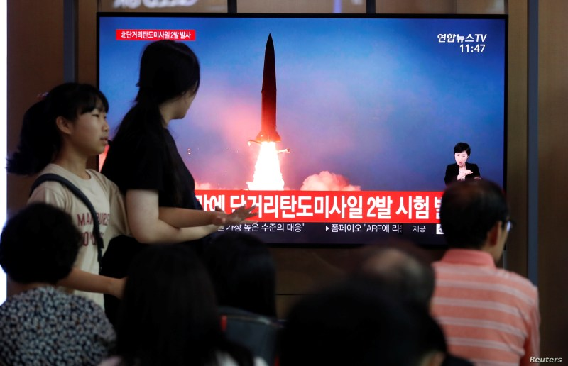 People watch a TV that shows a file picture of a North Korean missile for a news report on North Korea firing short-range ballistic missiles, in Seoul, South Korea, July 31, 2019.