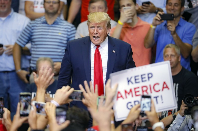 President Donald Trump arrives at a campaign rally at U.S. Bank Arena, Thursday, Aug. 1, 2019, in Cincinnati. (AP Photo/John Minchillo)