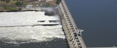 FILE - Water flows through the Dalles Dam, along the Columbia River, in The Dalles, Oregon, June 3, 2011.