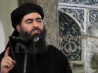 This file image made from video posted on a militant website July 5, 2014, purports to show the leader of the Islamic State group, Abu Bakr al-Baghdadi, delivering a sermon at a mosque in Iraq.