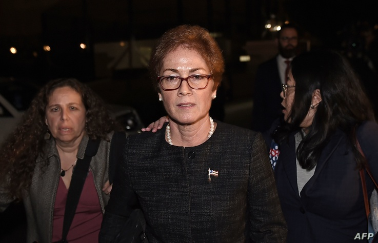 Former US Ambassador to Ukraine Marie Yovanovitch (C) flanked by lawyers, aides and Capitol police, leaves the US Capitol…
