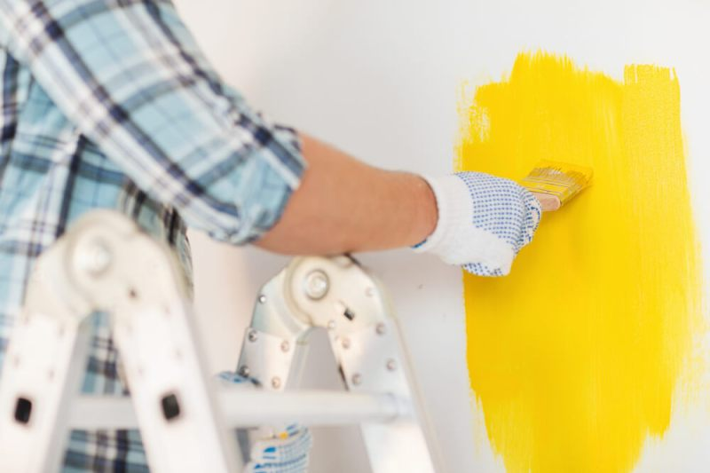 wear gloves-tips-for-a-mess-proof-DIY-wall-painting