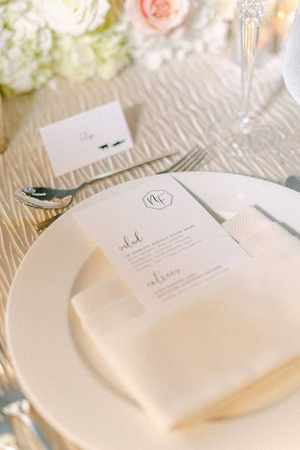Menu on top of white napkin and plate.