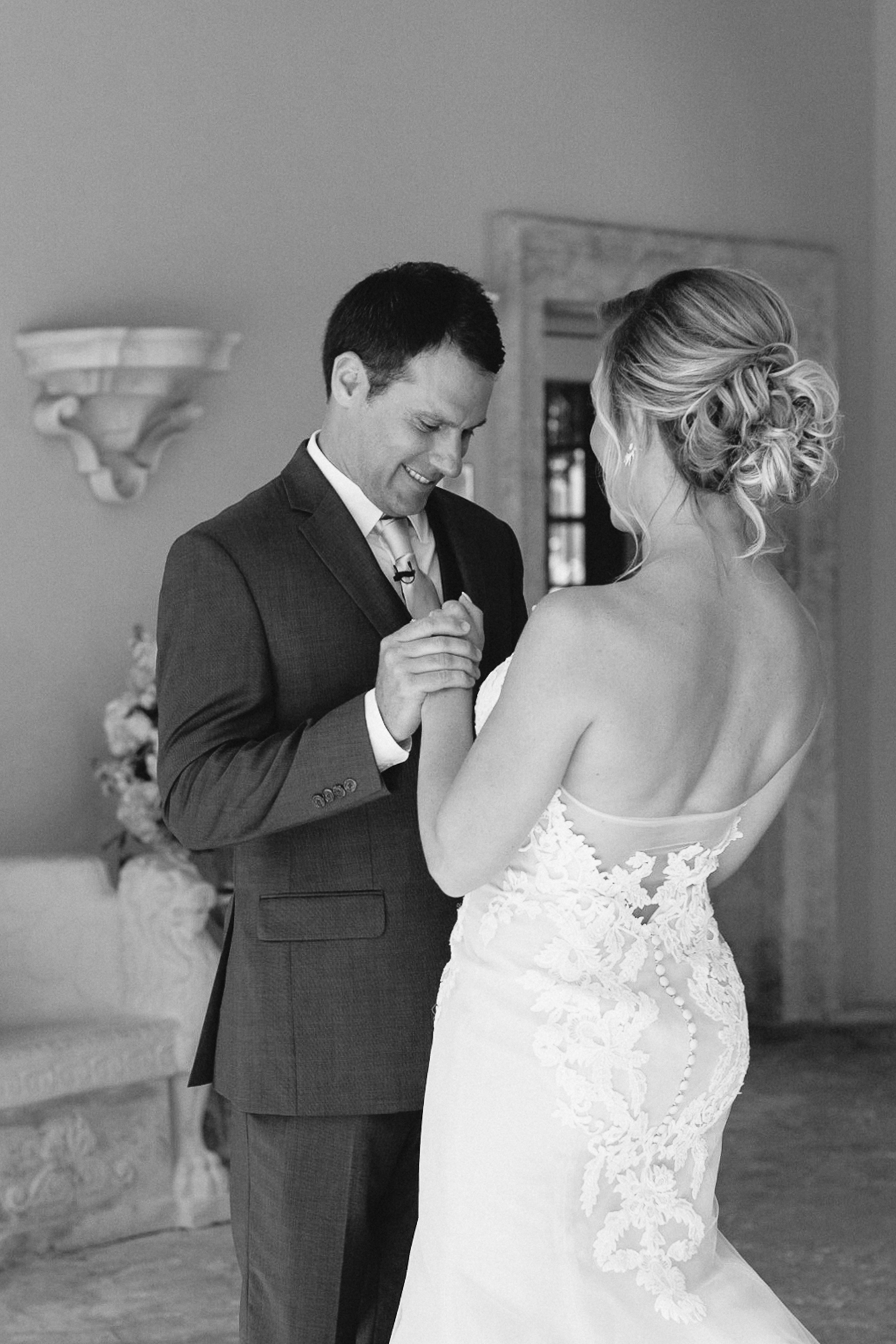 Black and white photo of couple looking towards each other for their first looks.
