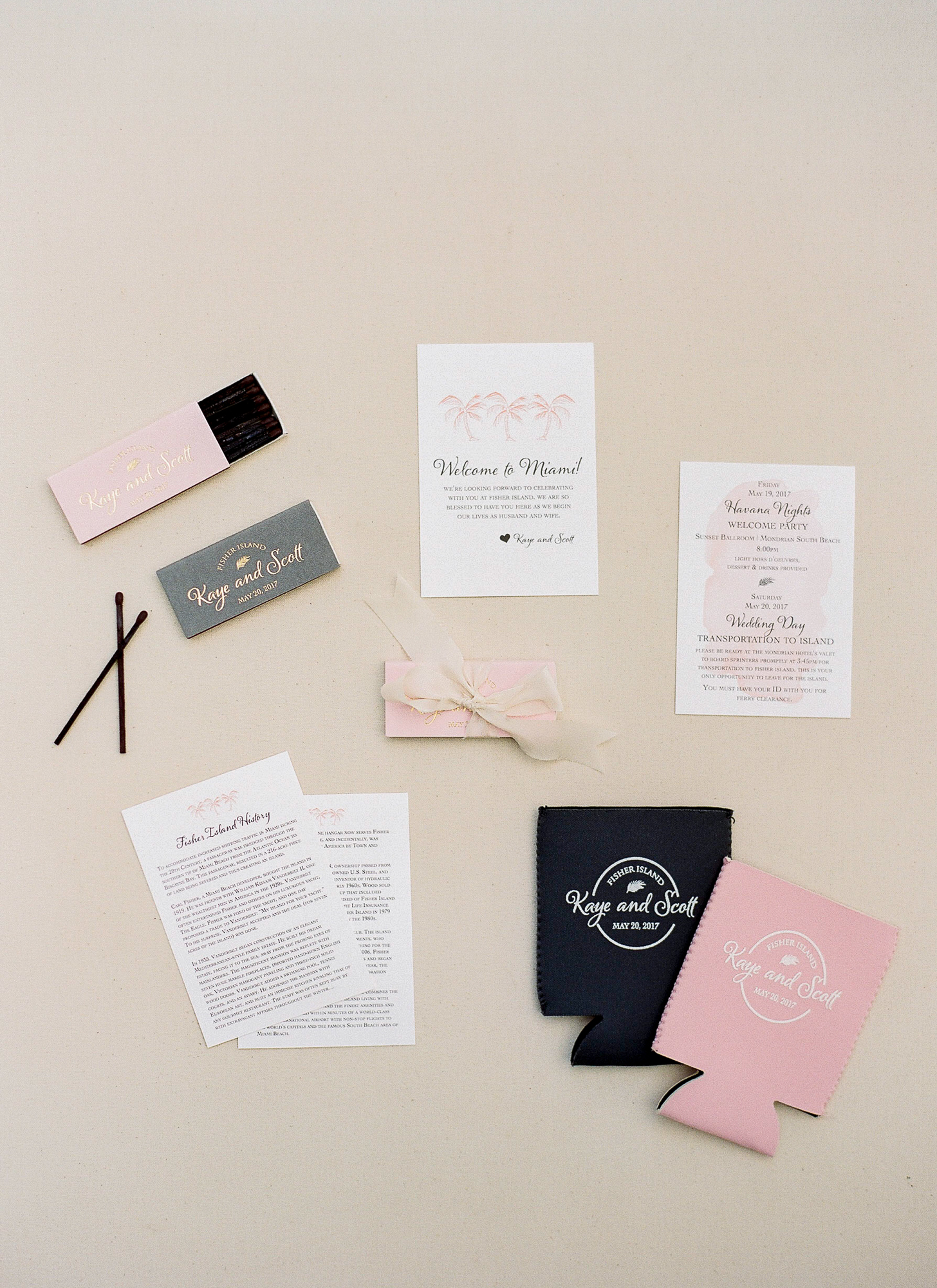 Invitation suite with matches and monogramed gifts.