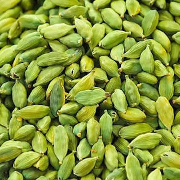 A pile of fresh green cardamon pods, elaichi