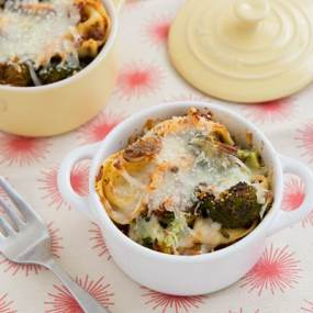 Cheese Tortellini Bake with Roasted Broccoli in white pot with fork