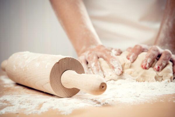 woman kneading dough close up photo