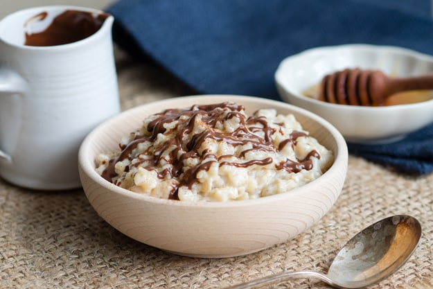15 Creamy & Dreamy Rice Pudding Recipes: Eggnog Rice Pudding with Chocolate Drizzle
