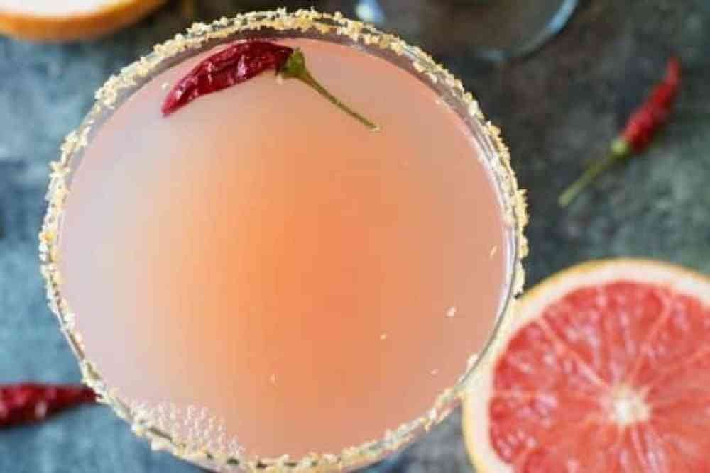 Refreshing Margarita Recipes to Cool You Down This Summer: Pink Grapefruit Margarita with Sriracha Salt