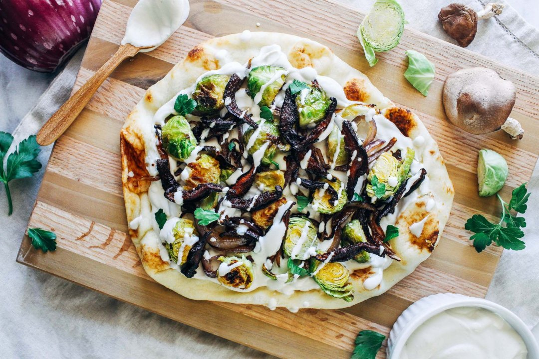 White Garlic Cashew Cream Pizza with Dijon Brussels and Crispy Shiitake Bacon