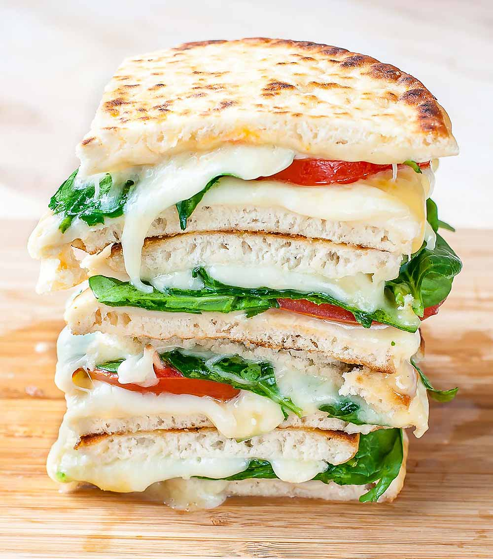 21 Mind-Blowing Grilled Cheese Sandwich Recipes: Spinach and Tomato Grilled Cheese Pitas