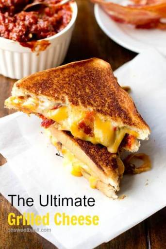 the ultimate grilled cheese on white parchment paper.