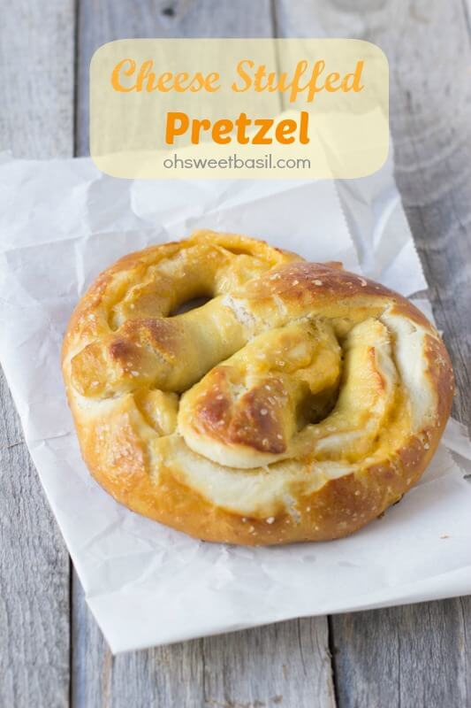 The best soft pretzel recipe and it happens to be stuffed with melty cheese! ohsweetbasil.com