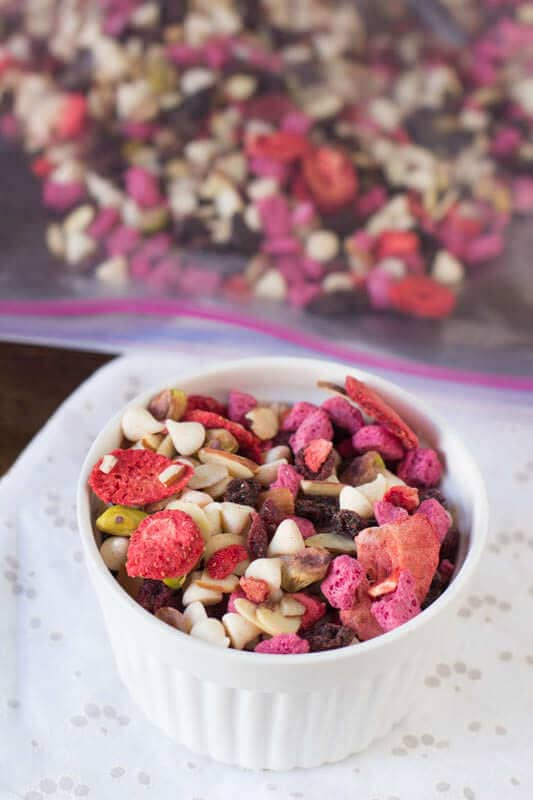 Trail mix is the perfect snack for school lunches or #afterschoolsnack And this one is our favorite with yogurt bites, fruit and chocolate! ohsweetbasil.com pistachio fruit and yogurt trail mix