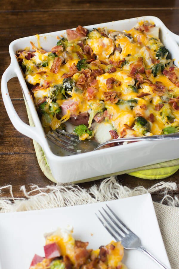 ham and cheese casserole in white baking dish