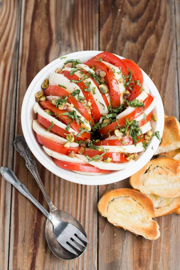 The BEST caprese salad with pistachios recipe is right here! There's nothing like finding a good recipe for fresh from the garden tomatoes.