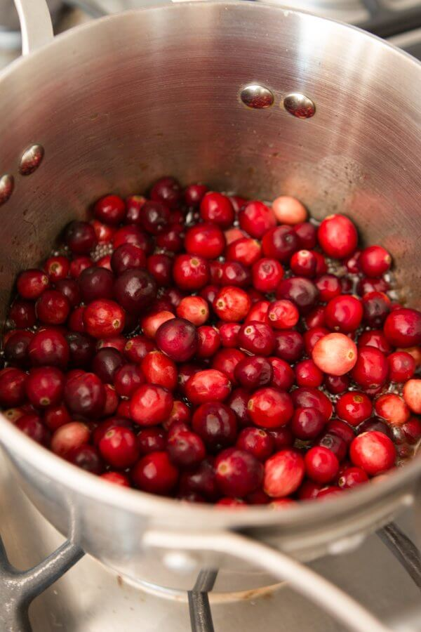 Our favorite cranberry sauce with a hint of orange and a secret ingredient that you will love! ohsweetbasil.com Better than Grandma's Spiced Orange Blackberry Cranberry Sauce
