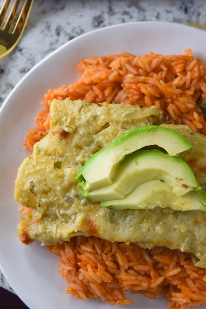 Cheesy chicken enchiladas baked with a homemade roasted tomatillo sauce.