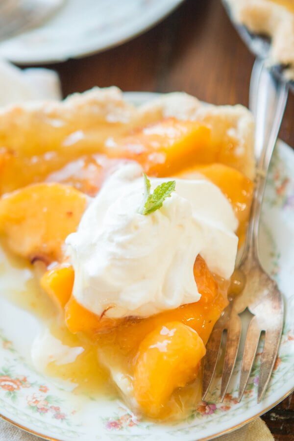 Wait, what?! Did she say lemon jello peach pie? I did and it is such a perfect way to enjoy all of those juicy globes of sweet nectar that are in season. OHSWEETBASIL.COM summer dessert, summer fruits