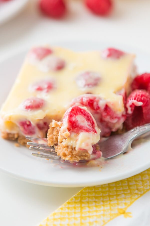 Lemon Raspberry Bars with a buttery graham cracker crust!
