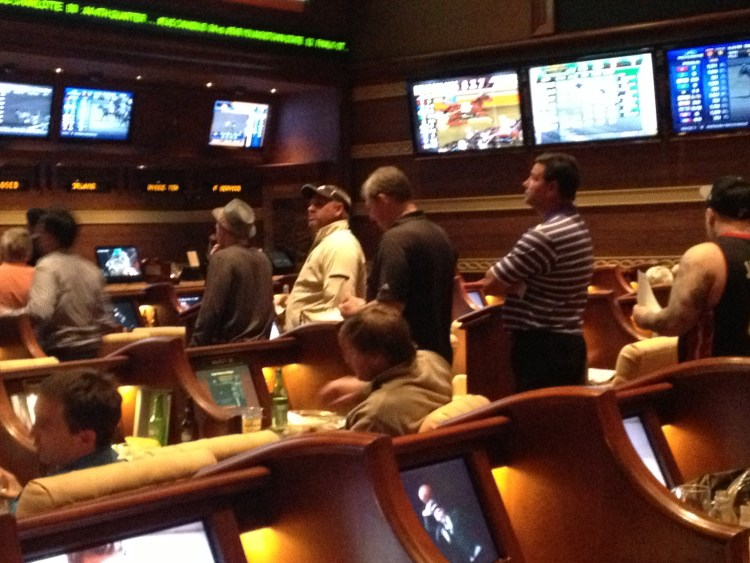 Lining up to cash out are these now-calm participants at the Wynn Las Vegas Race and Sports Book.
