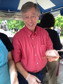 Alan Benton serving bacon at Biscuit Festival